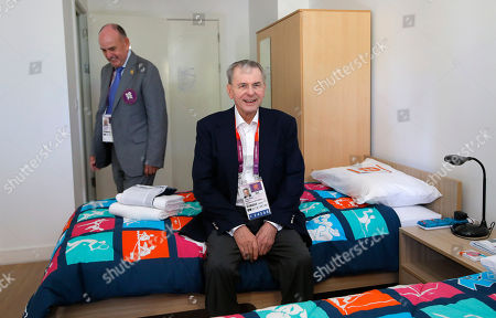 Jacques Rogge, Charles Allen IOC President Jacques Rogge, center, sits on a bed as he is accompanied by Charles Allen, village mayor, during his visit to the Athletes' Village at the Olympic Park, in London. More than 1 million items from the athletes village and Olympics Park are on sale right here, right now, and they'll be ready for collection right after the Paralympic Games end in early September. Included are; night stands, lamps, umpire's chairs an even beanbags