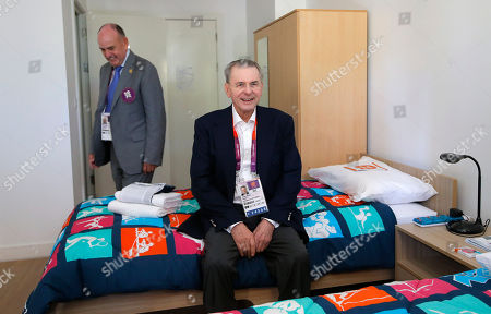 Jacques Rogge, Charles Allen IOC President Jacques Rogge, center, sits on a bed as he is accompanied by Charles Allen, village mayor, during his visit to the Athletes' Village at the Olympic Park, in London. More than 1 million items from the athletes village and Olympics Park are on sale here, and they'll be ready for collection right after the Paralympic Games end in early September. Included are: night stands, lamps, umpire's chairs and even beanbags