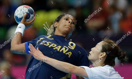 South Korea's Woo Sun-hee, right, tries to stop Spain's Marta Mangue during their women's handball preliminary match at the 2012 Summer Olympics, in London