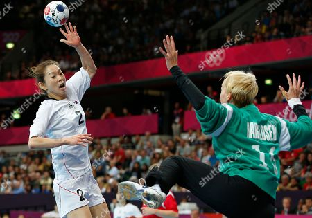 South Korea's Woo Sun-hee, left, scores past Norway's goalkeeper, Katrine Lunde Haraldsen, right, during their women's handball preliminary match at the 2012 Summer Olympics, in London