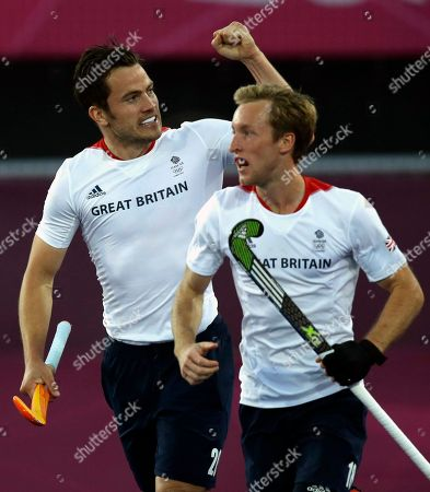 Barry Middleton, James Tindall Britain's James Tindall, left, celebrates his goal against Australia during the men's hockey preliminary match at the 2012 Summer Olympics, in London