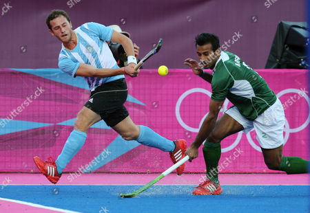 Lucas Vila, Fareed Rizwan Argentina's Lucas Vila, left, and Pakistan's Fareed Ahmed vie for the ball in the men's hockey preliminary match at the 2012 Summer Olympics, in London
