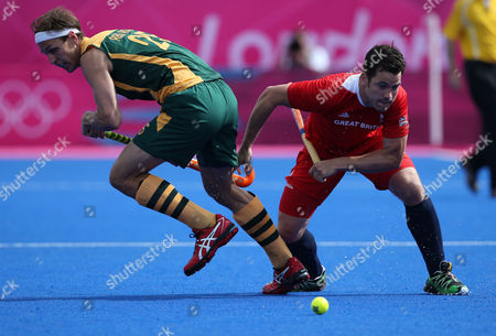 James Tindall, Justin Ried Ross Britain's James Tindall, right, and South Africa's Justin Ried Ross vie for the ball in the men's hockey preliminary match at the 2012 Summer Olympics, in London