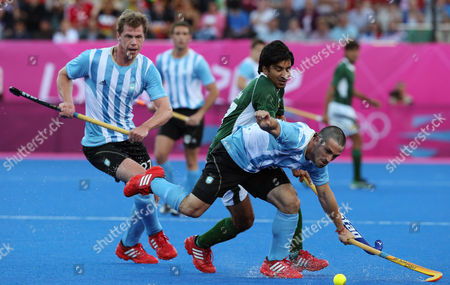 Lucas Vila, Fareed Rizwan, Lucas Rossy Argentina's Santiago Montelli, front, and Pakistan's Ahmed Waseem vie for the ball as Lucas Rossi, left, watches in the men's hockey preliminary match at the 2012 Summer Olympics, in London