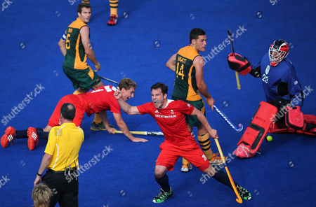 James Tindall Britain's James Tindall, third right, celebrates a goal against South Africa in the men's hockey preliminary match at the 2012 Summer Olympics, in London