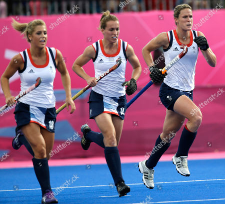 Georgi Twigg, Laura Bartlett, Crista Cullen Britain's Georgi Twigg, left, Laura Bartlett, center and Crista Cullen rush back to their positions following Cullen's goal during a women's hockey preliminary match against China at the 2012 Summer Olympics, in London. China won 2-1