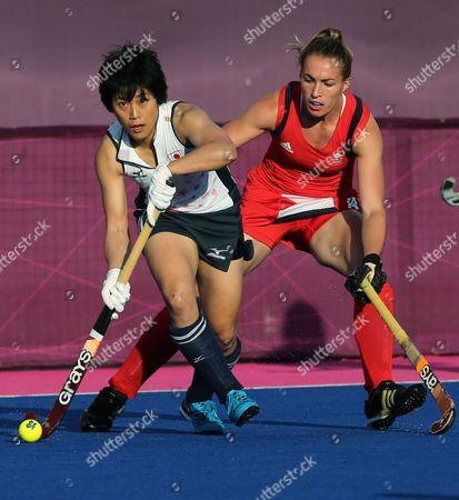 Rika Komazawa, Laura Bartlett Japan's Rika Komazawa, left, and Britain's Laura Bartlett vie for the ball during their women's hockey preliminary round match at the 2012 Summer Olympics, in London