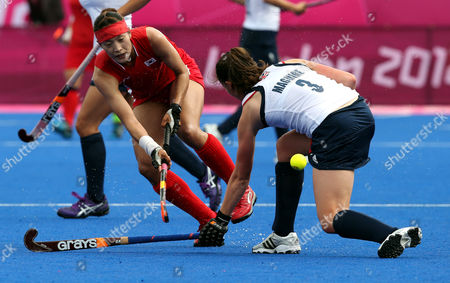 Jongeun Kim, Emily Maguire South Korea's Kim Jong-eun, left, and Britain's Emily Maguire vie for the ball during their women's hockey preliminary round hockey match at the 2012 Summer Olympics, in London