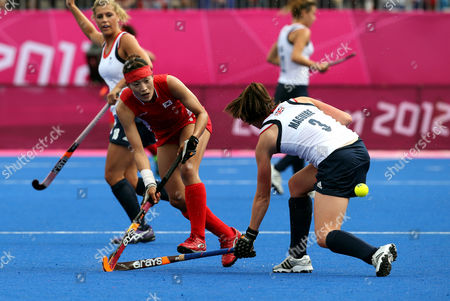 Kim Jongeun, Emily Maguire South Korea's Kim Jong-eun, left, and Britain's Emily Maguire vie for the ball during their women's hockey preliminary round match at the 2012 Summer Olympics, in London