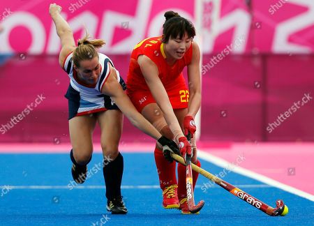 Qingling Song, Laura bartlett Britain's Laura Bartlett, left, and China's Qingling Song vie for the ball during their women's hockey preliminary round match at the 2012 Summer Olympics, in London