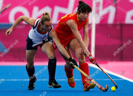 Qingling Song, Laura bartlett Britain's Laura Bartlett, left, and China's Qingling Song vie for the ball during a women's hockey preliminary round match at the 2012 Summer Olympics, in London