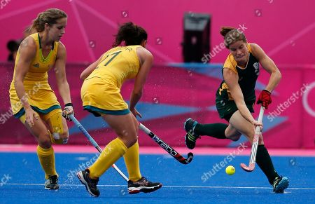 Jennifer Wilson, Jade Taylor South Africa's Jennifer Wilson, right, and Australia's Jade Taylor vie for the ball in the women's hockey preliminary round match at the 2012 Summer Olympics, in London