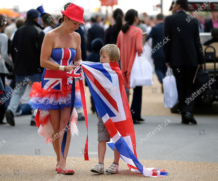 Anna Prior, left, ties a British flag around her son, Johnny Prior's neck, as they walk toward Olympic Stadium to watch the Opening Ceremony at the 2012 Summer Olympics, in London
