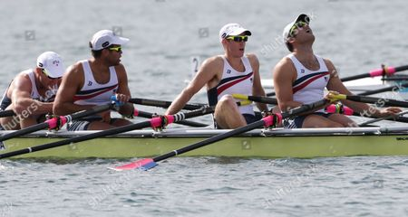 U.S. rowers Elliot Hovey, from right, Peter Graves, Alexander Osborne and Wesley Piermarini react after finishing last in a men's rowing quadruple sculls repechage in Eton Dorney, near Windsor, England, at the 2012 Summer Olympics