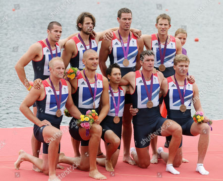 Great Britain's Phelan Hill, Constantine Louloudis, Matthew Langridge, Greg Searle, Mohamed Sbihi, Richard Egington, Tom Ransley, James Ford, and Alex Partridge pose with the bronze medal for the men's rowing eight in Eton Dorney, near Windsor, England, at the 2012 Summer Olympics