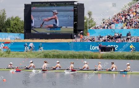 U.S. rowers, left to right, Mary Whipple, Caryn Davies, Caroline Lind, Eleanor Logan, Meghan Musnicki, Taylor Ritzel, Esther Lofgren, Zsuzsanna Francia, and Erin Cafaro stroke during a women's rowing eight heat in Eton Dorney, near Windsor, England, at the 2012 Summer Olympics