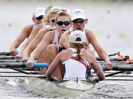 Coxswain Mary Whipple, foreground, and U.S. rowers, Caryn Davies, Caroline Lind, Eleanor Logan, Meghan Musnicki, Taylor Ritzel, Esther Lofgren, Zsuzsanna Francia, and Erin Cafaro race a women's rowing eight heat in Eton Dorney, near Windsor, England, at the 2012 Summer Olympics