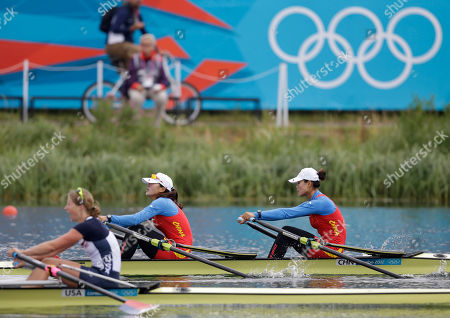 China's Zhu Weiwei and Wang Min, rear, stroke past U.S. rower Sarah Trowbridge to win a during a women's rowing double sculls repechage in Eton Dorney, near Windsor, England, at the 2012 Summer Olympics