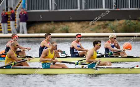 Great Britain's, from right at rear, Andrew Triggs Hodge, Tom James, Pete Reed and Alex Gregory, back, finish first during a men's rowing four semifinal in Eton Dorney, near Windsor, England, at the 2012 Summer Olympics, . Australia's Joshua Dunkley-Smith, Drew Ginn and James Chapman, who finished second, are in front