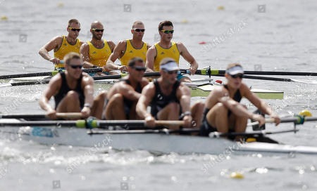 Australia's crew, at rear from right, Joshua Dunkley-Smith, Drew Ginn, James Chapman and William Lockwood stoke ahead of New Zealand's, from right, Chris Harris, Sean O'Neill, Jade Uru and Tyson Williams during a men's rowing four heat in Eton Dorney, near Windsor, England, at the 2012 Summer Olympics