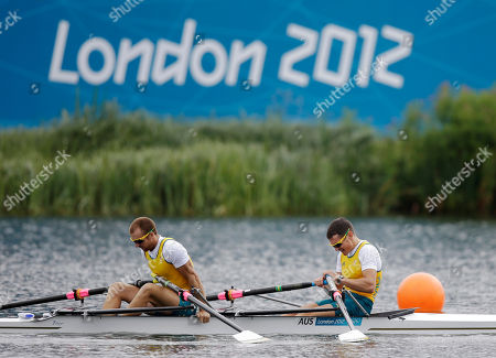 Australia's Thomas Gibson, left, and Roderick Chisholm look down after a lightweight men's rowing double sculls repechage in Eton Dorney, near Windsor, England, at the 2012 Summer Olympics, . The pair finished third and failed to qualify for the semifinals