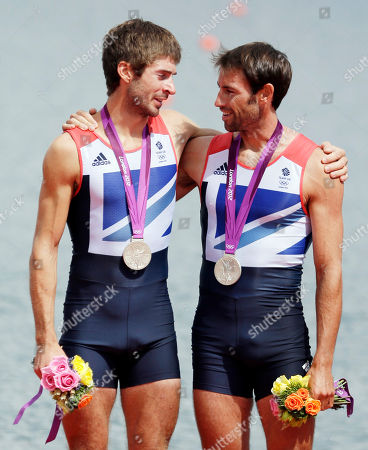 Great Britain's Mark Hunter, right,and Zac Purchase embrace after winning the silver medal for the lightweight men's rowing double sculls in Eton Dorney, near Windsor, England, at the 2012 Summer Olympics