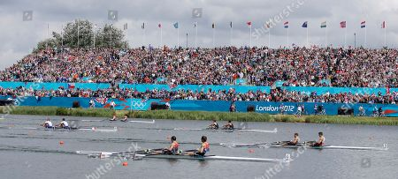 Denmark's Rasmus Quist and Mads Rasmussen, in boat 5, row on their way to winning the gold medal for the lightweight men's rowing double sculls in Eton Dorney, near Windsor, England, at the 2012 Summer Olympics, . Great Britain's Mark Hunter and Zac Purchase, boat 6, won the silver medal, and New Zealand's Peter Taylor and Storm Uru, in boat 3, won the bronze medal