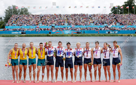 From left, Australia's Joshua Dunkley-Smith, Drew Ginn, James Chapman and William Lockwood, bronze medal, Great Britain's Andrew Triggs Hodge, Tom James, Pete Reed and Alex Gregory in Eton Dorney, gold medal, and U.S. rowers Scott Gault, Charles Cole, Henrik Rummel and Glenn Ochal, bronze medal, pose at the podium for the men's rowing four near Windsor, England, at the 2012 Summer Olympics