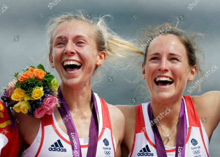 Great Britain's Katherine Copeland, left, and Sophie Hosking celebrate on the podium after winning the gold medal for the lightweight women's rowing double sculls in Eton Dorney, near Windsor, England, at the 2012 Summer Olympics