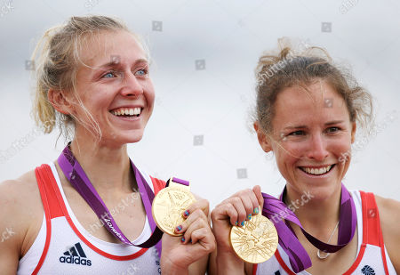 Great Britain's Katherine Copeland, left, and Sophie Hosking show their gold medals for the lightweight women's rowing double sculls in Eton Dorney, near Windsor, England, at the 2012 Summer Olympics