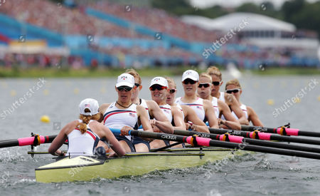 U.S. rowers Mary Whipple, Caryn Davies, Caroline Lind, Eleanor Logan, Meghan Musnicki, Taylor Ritzel, Esther Lofgren, Zsuzsanna Francia, and Erin Cafaro row on their way to winning the gold medal for the women's rowing eight in Eton Dorney, near Windsor, England, at the 2012 Summer Olympics