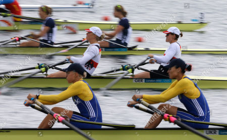 Stock Photo of Ukraine's Olena Buryak and Anna Kravchenko, bottom, Germany's Stephanie Schiller and Tina Manker, center, and U.S. rowers Sarah Trowbridge and Margot Shumway, leave the starting line in a women's rowing double sculls repechage in Eton Dorney, near Windsor, England, at the 2012 Summer Olympics