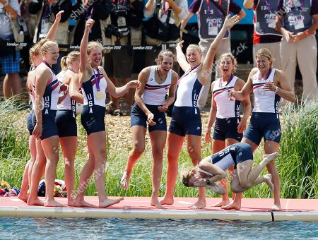 U.S. rowers, from left to right, Caryn Davies, Caroline Lind, Eleanor Logan, Meghan Musnicki, Taylor Ritzel, Esther Lofgren, Zsuzsanna Francia, and Erin Cafaro throw coxswain Mary Whipple into the water after winning the gold medal for the women's rowing eight in Eton Dorney, near Windsor, England, at the 2012 Summer Olympics