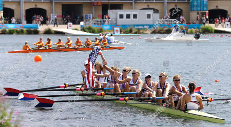 U.S. rowers Mary Whipple, Caryn Davies, Caroline Lind, Eleanor Logan, Meghan Musnicki, Taylor Ritzel, Esther Lofgren, Zsuzsanna Francia, and Erin Cafaro celebrate after winning the gold medal for the women's rowing eight in Eton Dorney, near Windsor, England, at the 2012 Summer Olympics