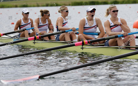 Taylor Ritzel, second from right, yaws, as she waits with teammates of the U.S. women's rowing eight team Meghan Musnicki, right, Esther Lofgren, third from left, Zsuzsanna Francia, second from left and Erin Cafaro, left, to start a women's rowing eight heat in Eton Dorney, near Windsor, England, at the 2012 Summer Olympics
