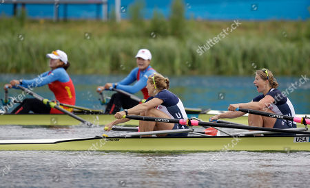 Stock Image of U.S. rowers Sarah Trowbridge and Margot Shumway, front, and China's Zhu Weiwei and Wang Min react after a women's rowing double sculls repechage in Eton Dorney, near Windsor, England, at the 2012 Summer Olympics, . China finished first and U.S. second and both qualified to the semifinal