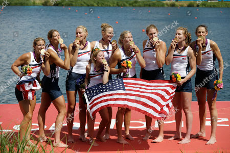 U.S. rowers, including coxswain Mary Whipple, center, Caryn Davies, Caroline Lind, Eleanor Logan, Meghan Musnicki, Taylor Ritzel, Esther Lofgren, Zsuzsanna Francia, and Erin Cafaro celebrate on the podium after winning the gold medal for the women's rowing eight in Eton Dorney, near Windsor, England, at the 2012 Summer Olympics