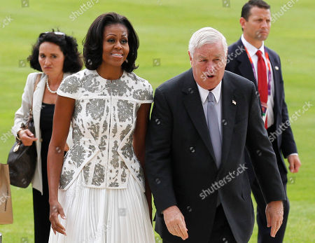 Michelle Obama, Louis B. Susman US's first lady Michelle Obama and U.S. Ambassador Louis B. Susman arrive at Buckingham Palace in London for a reception hosted by Queen Elizabeth II for the heads of state and governments prior to them attending the opening ceremony of London 2012 Olympic Games
