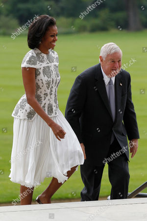 Stock Picture of Michelle Obama, Louis B. Susman US's First Lady Michelle Obama, left, and Ambassador Louis B. Susman arrive at Buckingham Palace in London for a reception hosted by Queen Elizabeth II for the heads of state and governments prior to them attending the opening ceremony of the London 2012 Olympic Games