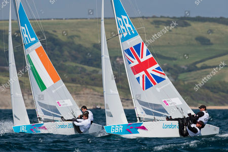 Britain's Star crew Iain Percy, and Andrew Simpson, right, and Ireland's Star crew Peter O'leary and David Burrows train during an official practice race at the London 2012 Summer Olympics, in Weymouth and Portland