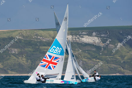 Britain's Star crew Iain Percy, and Andrew Simpson, left, and Ireland's Star crew Peter O'leary and David Burrows train during an official practice race at the London 2012 Summer Olympics, in Weymouth and Portland