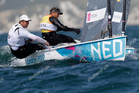 Netherland's Pieter-Jan Postma, foreground, and Denmark's Jonas Hogh Christensen compete during the finn dinghy class race at the London 2012 Summer Olympics, in Weymouth and Portland, England
