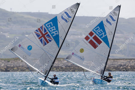 Ben Ainslie of Great Britain, left, and Denmark's Jonas Hogh-Christensen, right, compete during the finn class medal race at the London 2012 Summer Olympics, in Weymouth and Portland, England. Ainslie won the gold medal, Hogh-Christensen won the silver medal and France's Jonathan Lobert won the bronze medal