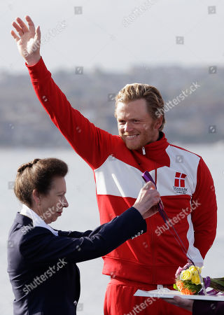Princess Anne gives the silver medal to Denmark's Jonas Hogh-Christensen during the finn medal ceremony at the London 2012 Summer Olympics, in Weymouth and Portland, England