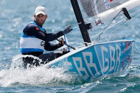 Ben Ainslie of Great Britain practices before starting the finn class medal race at the London 2012 Summer Olympics, in Weymouth and Portland, England. Ainslie won the gold medal, Denmark's Jonas Hogh-Christensen won the silver medal and France's Jonathan Lobert won the bronze medal