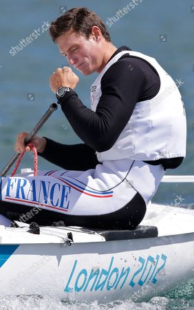 France's Jonathan Lobert celebrates after winning the bronze medal of the finn class sailing competition at the London 2012 Summer Olympics, in Weymouth and Portland, England. Great Britain's Ben Ainslie won the gold medal and Denmark's Jonas Hogh-Christensen won the silver medal