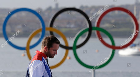 Ben Ainslie of Great Britain arrives at the finn class medal ceremony at the London 2012 Summer Olympics, in Weymouth and Portland, England. Ainslie won the gold medal, Denmark's Jonas Hogh-Christensen won the silver medal and France's Jonathan Lobert won the bronze medal
