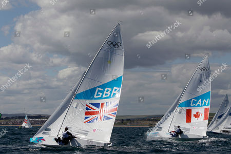 Andrew Simpson, Iain Percy, Tyler Bjorn, Richard Clark Andrew Simpson and Iain Percy of Great Britain, left and Tyler Bjorn and Richard Clark of Canada sail on a Star class during the official practice race ahead of the London 2012 Summer Olympics, in Weymouth and Portland venue