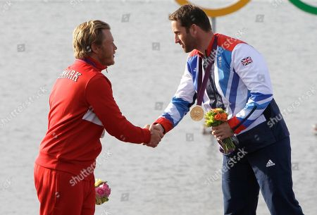 Ben Ainslie, Jonas Hogh-Christensen Ben Ainslie of Great Britain, right, winner of the gold medal, shakes hands with silver medallist Jonas Hogh-Christensen of Denmark after the Finn class sailing competition at the London 2012 Summer Olympics, in Weymouth and Portland, England