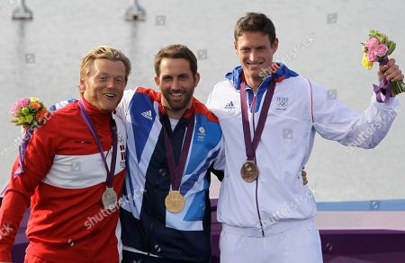 Ben Ainslie, Jonas Hogh-Christensen, Jonathan Lobert Gold medalist Ben Ainslie of Great Britain, center, silver medallist Jonas Hogh-Christensen of Denmark, left, and bronze medalist Jonathan Lobert of France stand after the Finn class sailing competition at the London 2012 Summer Olympics, in Weymouth and Portland, England
